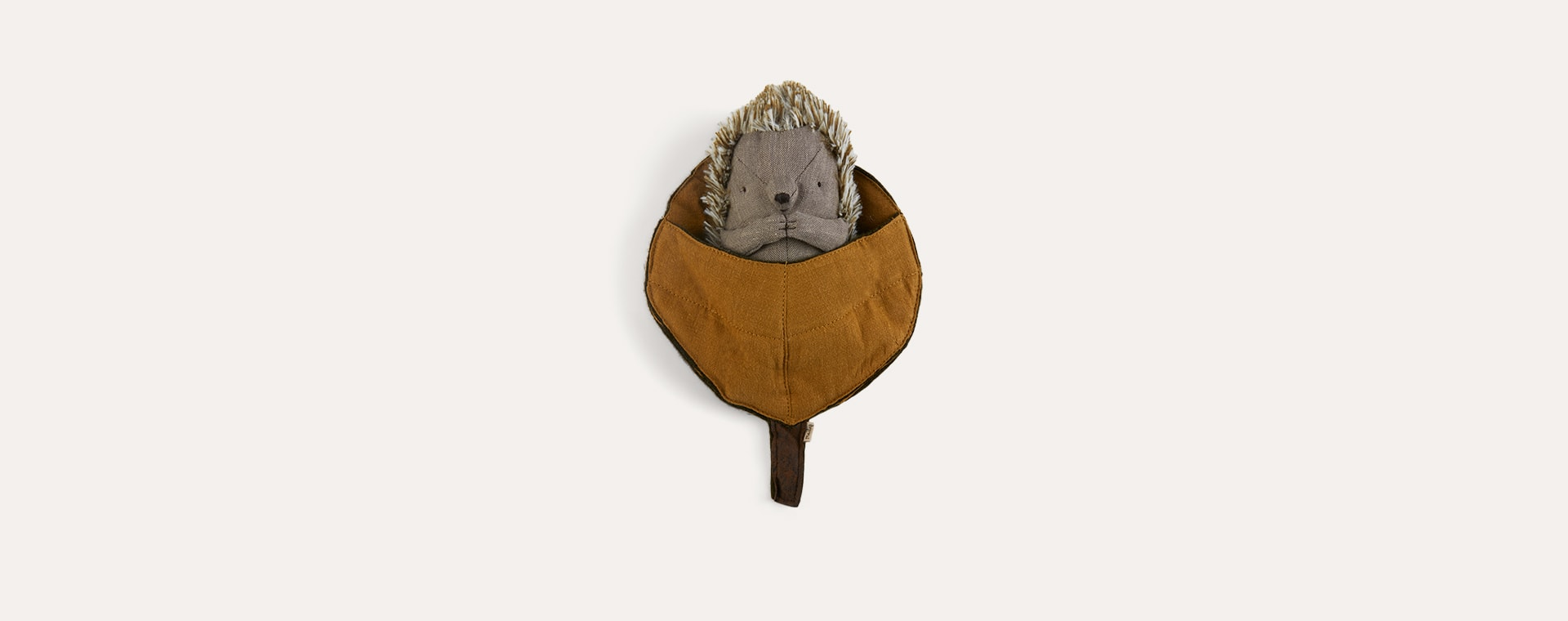 Brown Maileg Hedgehog in leaf