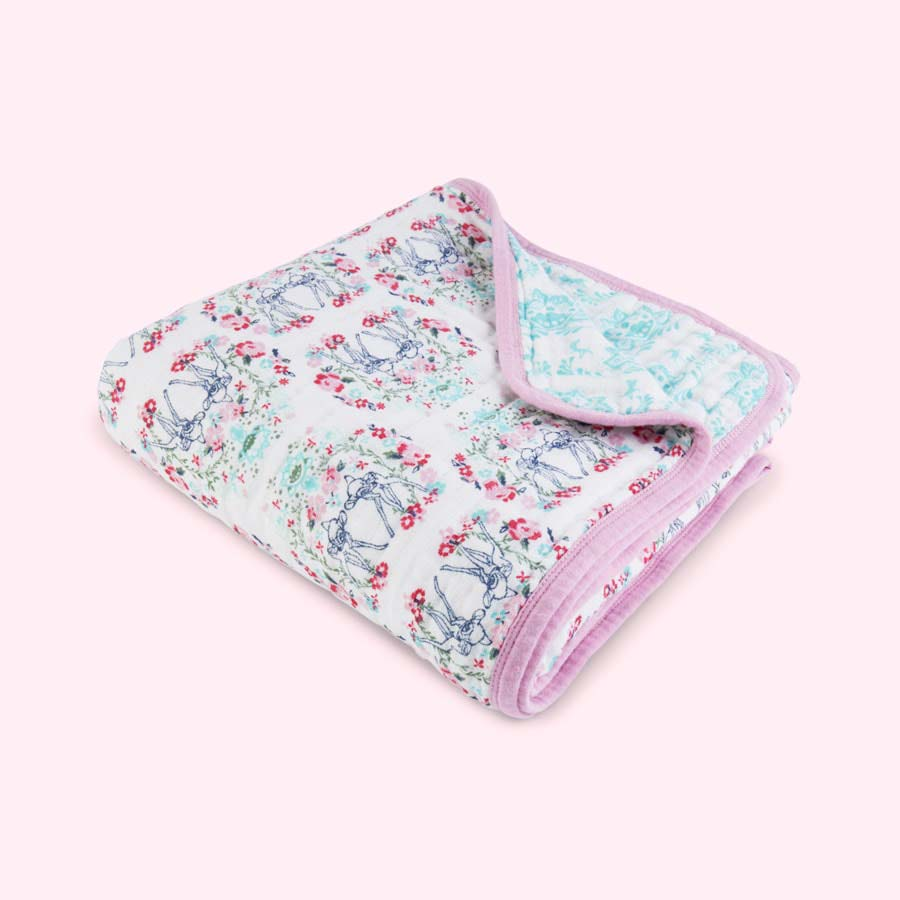 Aden and Anais Dream Blanket The muslin swaddle blankets are warmer than you'd expect, but perhaps not enough for use in the colder months (or with an older child). If you'd like something similar but warmer, look into the Aden+Anais Dream blanket.