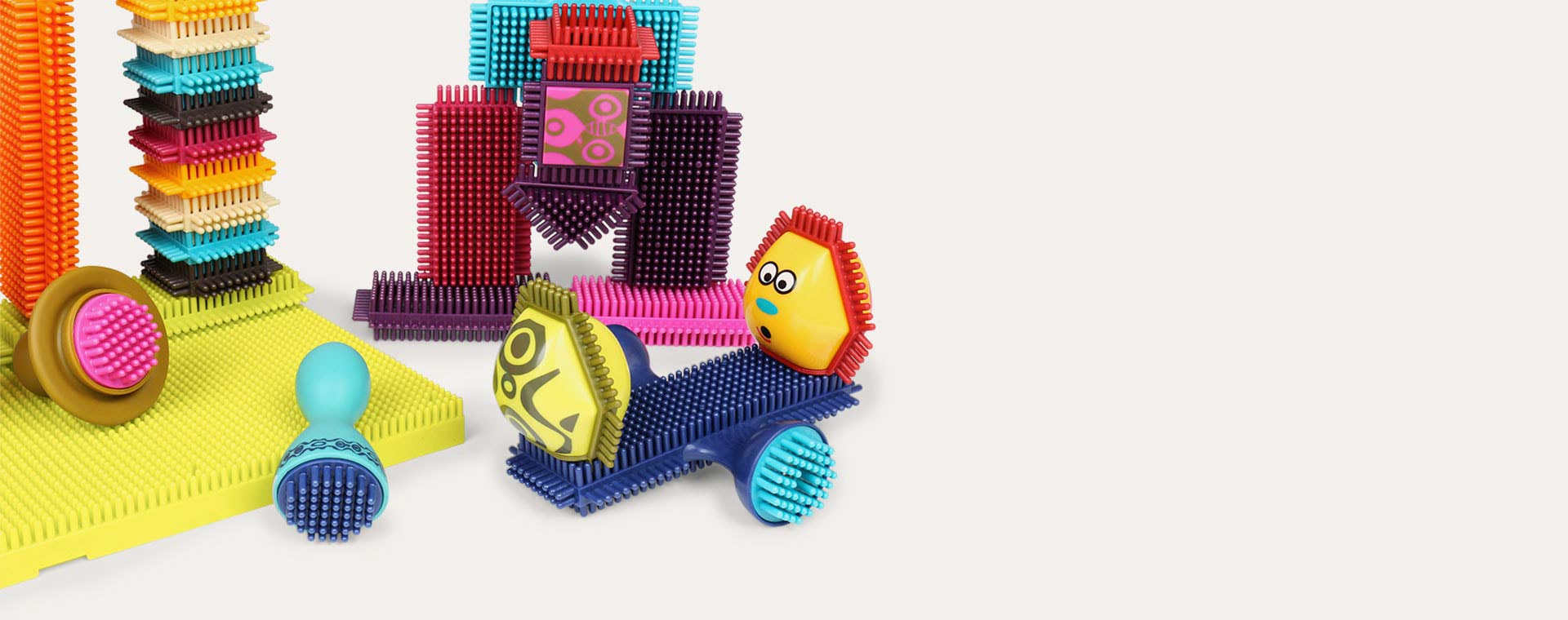 Multi B. Toys Bristle Block Spinaroos