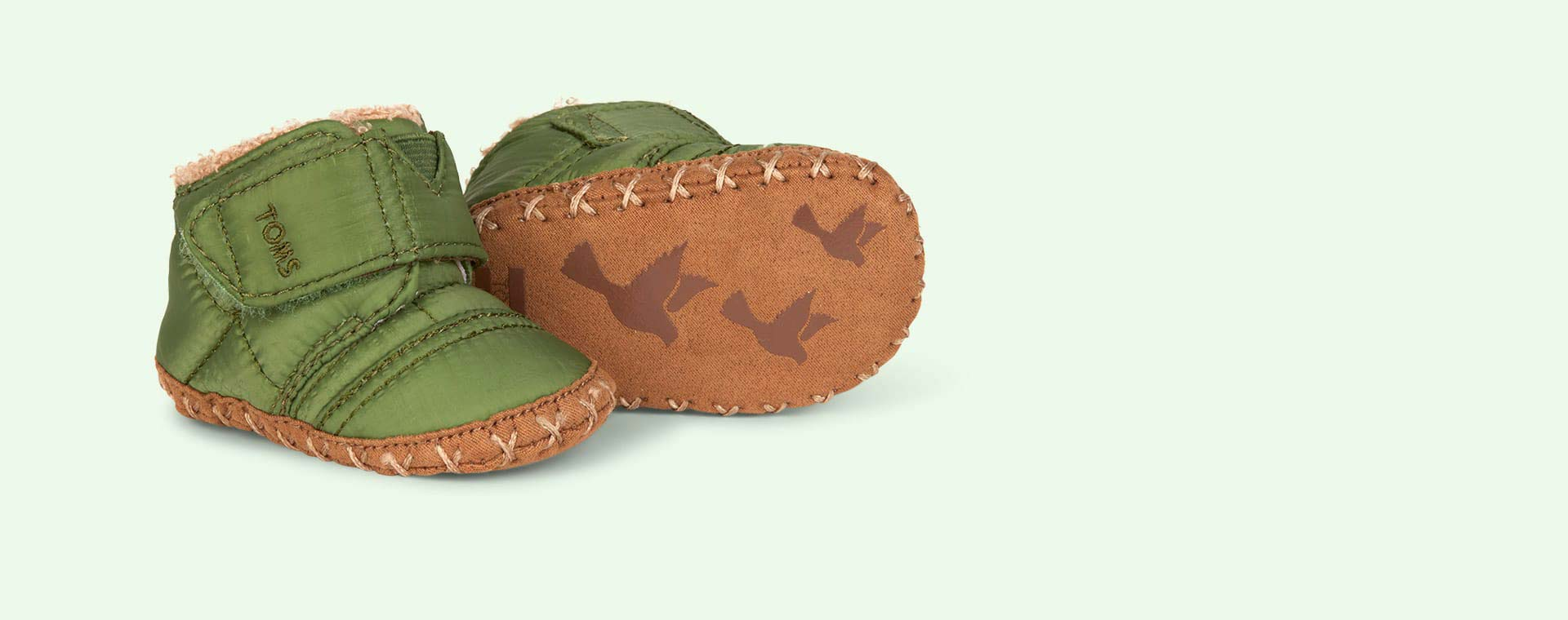 Green TOMS Cuna Quilted Crib Shoe